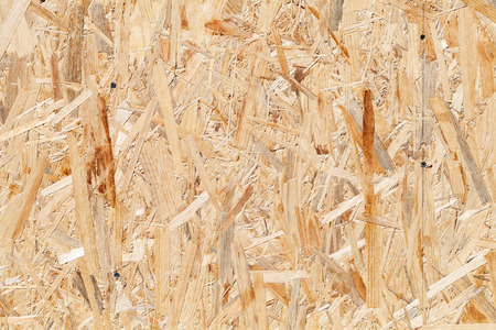 Oriented strand board OSB. Sterling board with screws background photo texture