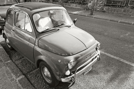 fiat: Ischia, Italy - August 15, 2015: Old Fiat 500 city car stands parked on urban roadside Editorial