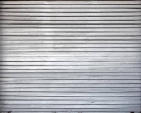 metal wall: Gray roller shutter metal garage gate, background photo texture