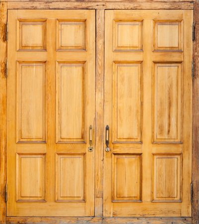 exterior house: Closed old wooden door, classical architecture background texture Stock Photo