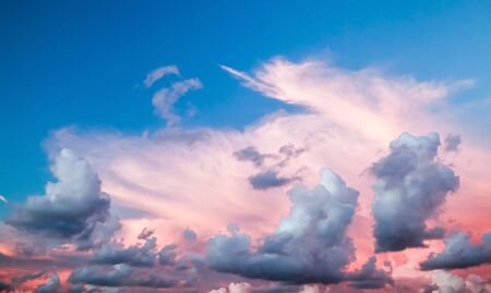 colorful cloudscape: Dramatic colorful cloudscape, summer evening sky background with different types of clouds: cirrus, altocumulus, nimbostratus, cumulus, stratocumulus