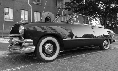 custom car: Helsinki, Finland - June 13, 2015: Old Ford Custom Deluxe Tudor car is parked on the roadside. 1951 year modification with convertible roof Editorial