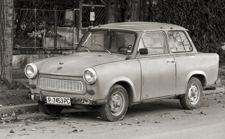 inefficient: Ruse, Bulgaria - September 29, 2014: Old Trabant 601s car stands parked on a street side. It was the most common vehicle in East Germany with inefficient two-stroke engine