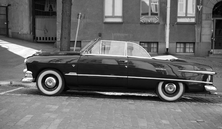 deluxe: Helsinki, Finland - June 13, 2015: Old Ford Custom Deluxe Tudor car is parked on the roadside. 1951 year modification with convertible roof, side view Editorial
