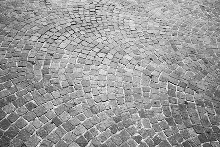 cobblestone road: Gray granite cobblestone road pavement. Background photo texture