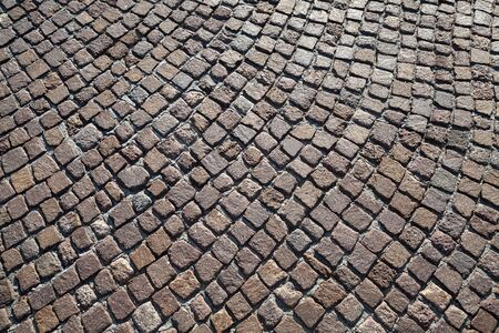 cobblestone road: Brown granite cobblestone road pavement with round pattern. Background photo texture Stock Photo