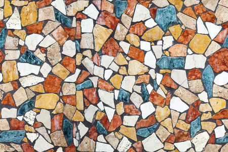 Colorful stone mosaic with chaotic pattern, seamless background photo texture