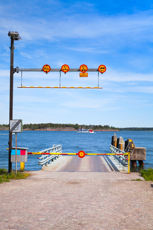 turnpike: Small empty ferry terminal with metal ramp, cosed turnpike and roadsigns Stock Photo