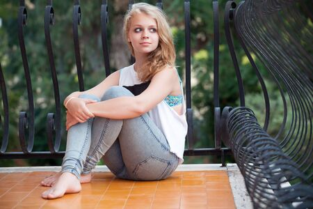 russian girl: Beautiful blond Caucasian teenage girl on balcony, outdoor summer portrait