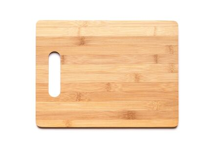 bamboo: New cutting board made of bamboo planks on white table background with shadow