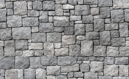 tiled wall: Old gray stone wall, seamless background photo texture