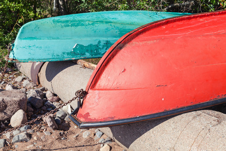rowboats: Old colorful rowboats lay on the coast. Gulf of Finland, Russia Stock Photo