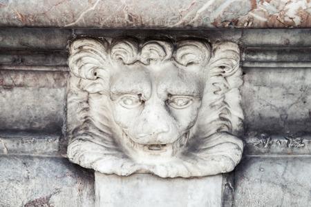 heads old building facade: Lion head sculpture, decorative detail of fountain in Italy, Roma. Piazza della Rotonda. Fontana del Pantheon Stock Photo