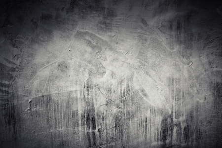 Dark concrete wall with whitewash layer and vignette photo effect, background texture