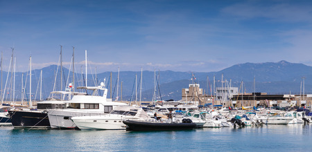 motorboats: Sailing yachts and pleasure motorboats moored in marina of Ajaccio, Corsica, France Stock Photo