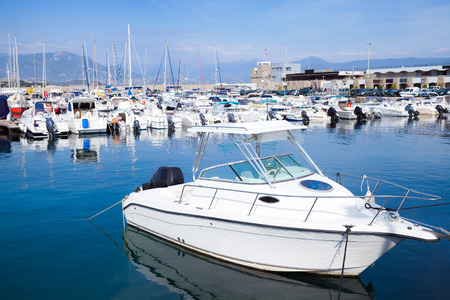 pleasure: White pleasure motor-boat floats moored in marina of Ajaccio, Corsica island, France