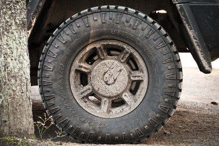 dirty car: Saint-Petersburg, Russia - October 11, 2015: Dirty wheel with logotype of a Hummer H2 car Editorial