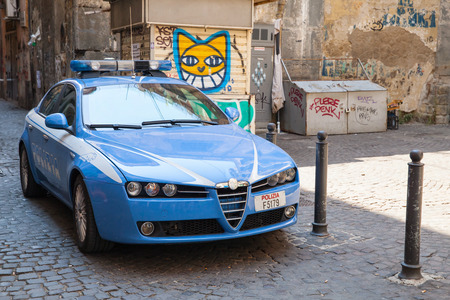 alfa: Naples, Italy - August 09, 2015: Blue Alfa Romeo 159 Pantera, police car on a street in Naples Editorial