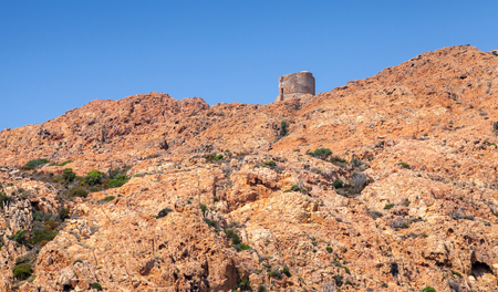 genoese: Ancient Genoese tower on the top of Capo Rosso. Piana region, Corsica island, France