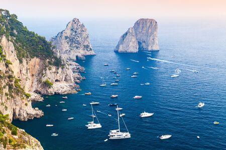 yacht: Capri island, Italy. Mediterranean Sea coastal landscape with rocks and yachts
