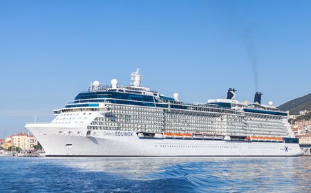 equinox: Ajaccio, France - June 30, 2015: White Celebrity Equinox cruise ship moored in Ajaccio, Corsica. It is the second of five Solstice-class vessels, owned and operated by Celebrity Cruises