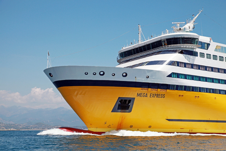 ship bow: Ajaccio, France - June 30, 2015: Mega Express ferry, big yellow passenger ship operated by Corsica Ferries Sardinia Ferries shipping company, bow fragment