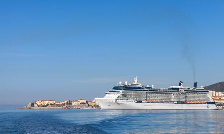 Ajaccio, France - June 30, 2015: White Celebrity Equinox cruise ship moored in Ajaccio, Corsica. It is the second of five Solstice-class vessels, owned and operated by