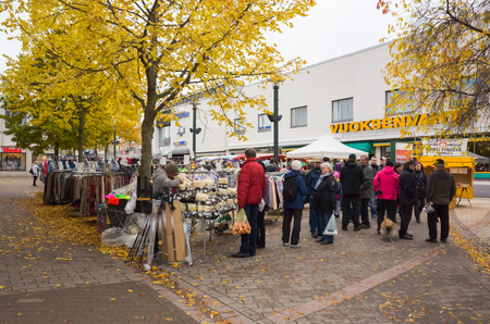 seasonal clothes: Imatra, Finland - October 25, 2015: Seasonal street Fair in Finland, people walk between the stalls with clothes Editorial