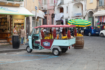 Ischia, Italy - August 15, 2015: Limoncello Advertising Ape Car, it is a three-wheeled light commercial vehicle produced since 1948 by Piaggio