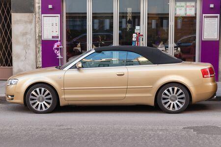 2 november: Vienna, Austria - November 2, 2015: metallic gold Audi A4 Cabriolet stands on the city street