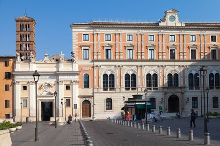 sylvester: Rome, Italy - August 8, 2015: Piazza di San Silvestro, street view with walking tourists and Church of Saint Sylvester the First on a background Editorial