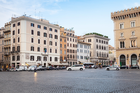 old building facade: Rome, Italy - August 7, 2015: Piazza Venezia, street view with walking tourists and cars