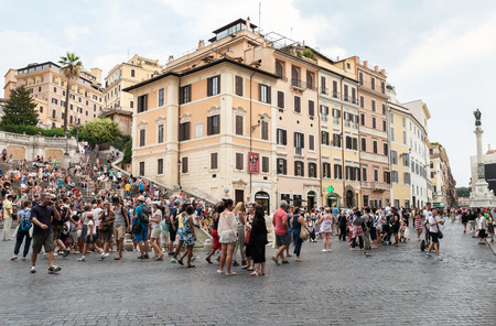 spagna: Rome, Italy - August 7, 2015: Crowd of tourists walking around Fontana della Barcaccia on the Piazza di Spagna, summer day