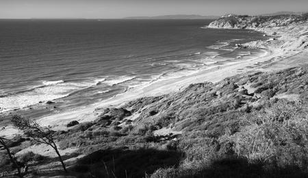 ourdoor: Atlantic Ocean coast in summer. Coastal landscape of Gibraltar strait, Morocco. Black and white photo Stock Photo