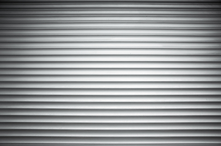 ridged: White ridged metal wall background texture with vignette shadow effect