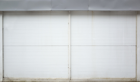 ridged: White ridged garage metal wall, background photo texture Stock Photo