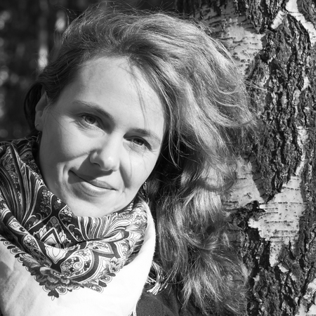 european white birch: Outdoor monochrome portrait of smiling Young Caucasian woman in traditional Russian Pavloposadskie neck scarf