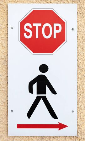 direction signs: No way, stop sign with schematic black man and red arrow of bypass direction Stock Photo
