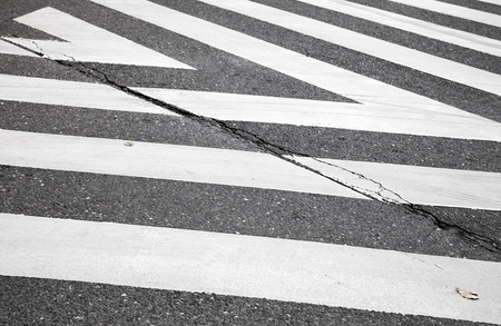 road marking: Dark gray asphalt road with pedestrian crossing road marking zebra, abstract transportation background