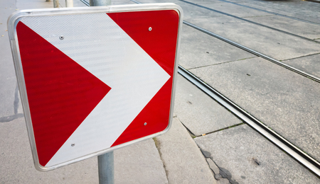 road side: Dangerous turn right, red and white roadsign on urban road side Stock Photo