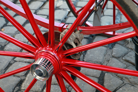 cart road: Red wheel of horse carriage with automobile disc brake. Vienna, Austria