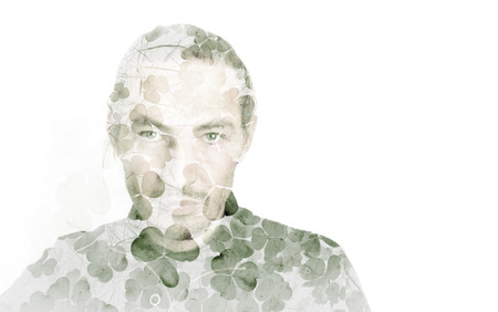 one person: Portrait of young man combined with natural green wild clover leaves background, double exposure photo effect