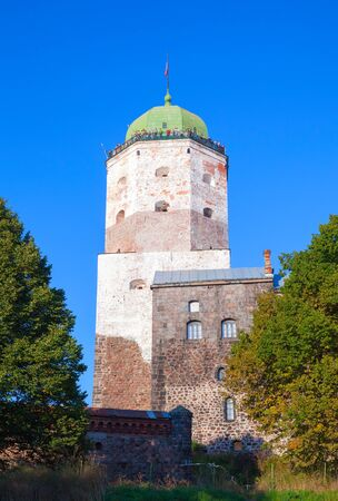 vyborg: Vyborg, Russia - September 12, 2015: Vyborg Castle with tourists walking on observation deck on the roof Editorial