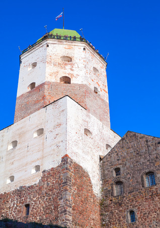 vyborg: Vyborg, Russia - September 12, 2015: Tower of Vyborg Castle with tourists walking on observation deck on the roof