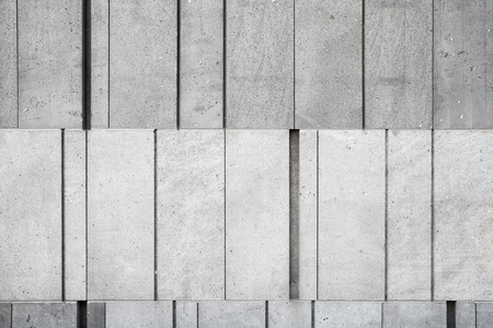 concrete structure: Gray concrete wall made of different size blocks, background photo texture