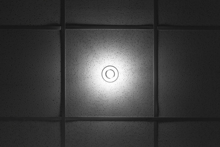 built in: White round lamp built in the office ceiling Stock Photo