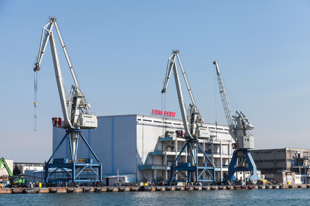 water transportation: Burgas, Bulgaria - July 22, 2014: Cargo cranes on the coast of Fish port of Burgas, Bulgaria Editorial