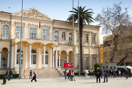 goverment: Izmir, Turkey - February 5, 2015: Ordinary people walking in front of  Izmir Goverment Office, Konak square Editorial