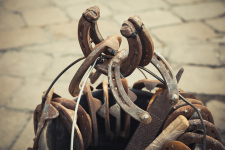 tonal: Large group of old steel rusted horseshoes, vintage tonal correction filter, old style photo