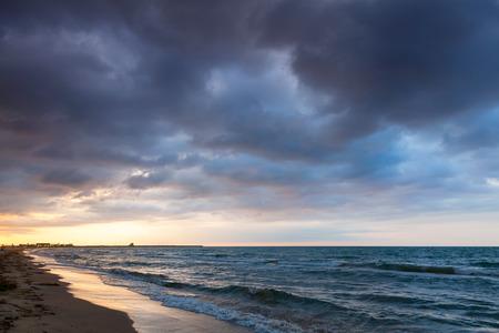 colorful cloudscape: Dramatic colorful cloudscape, Mediterranean sea coast at sunrise. Calafell, Spain